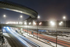 Transport metropolis, traffic and blurry lights. Of cars on multi-lane highways and road junction at night in Moscow royalty free stock photo
