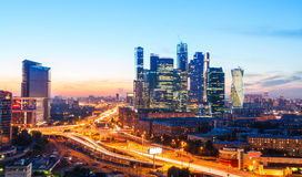 Transport metropolis, traffic and blurry lights. High-rise buildings and transport metropolis, traffic and blurry lights of cars on multi-lane highways and road stock photo