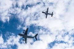 Transport military aircrafts flying in formation Stock Image