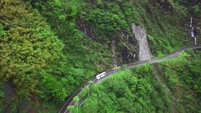 Transport Moving along Winding Curved Serpentine Mountain Road in Taroko Gorge National Park in Taiwan. Aerial View. Shot with a DJI Mavic fps 29,97 4k stock video