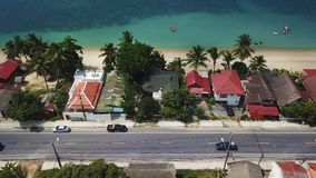Transport Moving on Street along Beach. Aerial View. With a DJI Mavic fps29,97 4k stock video footage