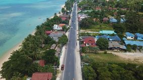 Transport Moving on Street along Beach. Aerial View. With a DJI Mavic fps29,97 4k stock video