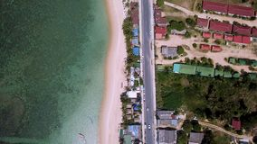 Transport moving on street along beach. Aerial view. Shot with a DJI Mavic fps29,97 4k stock video