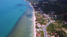 Transport Moving on Street along Beach. Aerial View. Shot with a DJI Mavic fps29,97 4k stock video footage