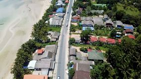 Transport Moving on Street along Beach. Aerial View. Shot with a DJI Mavic fps29,97 4k stock footage