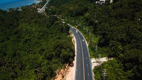 Transport moving on street among jungles. Shot with a DJI Mavic fps29,97 4k stock footage