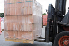 Transport pallet brick with a lift truck Stock Photography