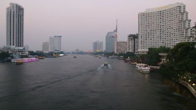 Transport a passenger boat in the river. Time Lapse,Bangkok city evening with transport a passenger boat in the river stock video