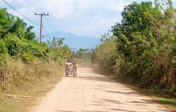 On a rural road. Vang Vieng. Laos. Royalty Free Stock Photo