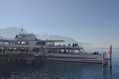 Transport ship anchored in montreux embarking passengers. Montreux, Switzerland - 02 17, 2019: Transport ship anchored in montreux embarking passengers stock photography