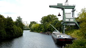 Transport ship on the Spree river. A video of a transport ship loading on the river Spree in Berlin, Germany stock footage