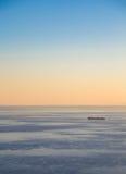 Transport ship at sunset Royalty Free Stock Photos