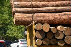 Transport stacked chopped wood logs renewable energy on flat back lorry truck. Transportation stacked chopped wood logs renewable energy on flat back lorry truck royalty free stock images