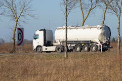 Transport by tanker. Tanker truck carrying fuel on the road Stock Photos