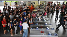 Transport Ticket Barrier. Travellers pass through a ticket barrier at a city centre BTS Skytrain station on June 1, 2013 in Bangkok, Thailand. The Thai capital's Stock Photo