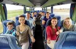 Group of happy passengers travelling by bus stock photography