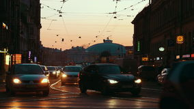 Transport traffic in evening St. Petersburg, Russia. SAINT PETERSBURG, RUSSIA - MARCH 26, 2016: Evening in the city. Cars with head lamps on driving in the stock video