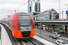 Transport and traffic of the modern metropolis. MOSCOW, RUSSIA - October 2, 2016: Transport and traffic of the modern metropolis. High-speed train and the royalty free stock images