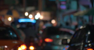 Transport traffic at night. Bangkok, Thailand. Defocused shot of cars and motorbikes traffic on the city roads of Bangkok, Thailand. Logos washed out stock footage