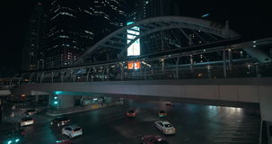 Transport traffic and pedestrian bridge in night city stock footage