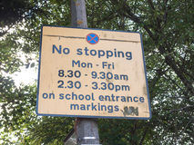 Transport and traffic sign outside school yellow no stopping stock photo