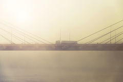 Transport truck on a highway with fog and sunrise Stock Photo