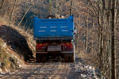 Transport by truck. Mountain road construction Royalty Free Stock Images