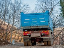 Transport by truck. Mountain road construction Royalty Free Stock Image
