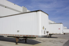 Transport truck trailers in yard. With warehouse and sky Stock Images