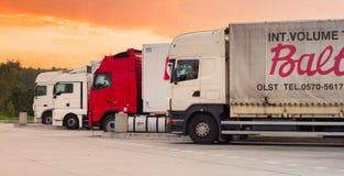 Transport trucks on sludge Stock Image