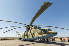 Transport universal military helicopter MI-26 and visitors of the exhibition. KADAMOVSKIY TRAINING GROUND, ROSTOV REGION, RUSSIA, 26 AUGUST 2018: Transport royalty free stock images