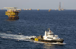 Transport vessel and rigs stock photo