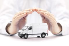 Free Transport White Van Car Protected By Hands Stock Images - 117142104