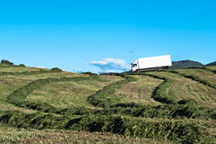 Transportation. Lorry driving through a farm in Norway Royalty Free Stock Photo