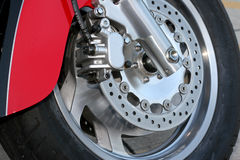 Transportation. Front tire of a motorcycle Royalty Free Stock Photography