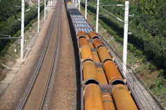 Transportation. Train loaded steel pipes on the railway Royalty Free Stock Photography