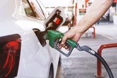 Free Transportation And Ownership Concept.Man Pumping Gasoline Fuel In Car At Gas Station Royalty Free Stock Images - 183567539