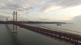 Cars, trains, bus on 25 April bridge in Lisbon aerial view stock footage