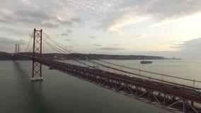 Cars, trains, bus on 25 April bridge in Lisbon aerial view. Transportation on 25 April bridge in Lisbon stock footage