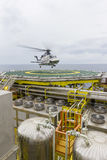 Transportation. Aviation transportation. View of commercial helicopter depart after taking offshore passengers on oil and gas platform with background of South royalty free stock photos