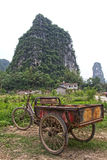 Transportation bicycle in a Chinese landscape Royalty Free Stock Images