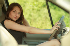 Transportation. Brunette woman driving a car Stock Photos