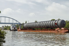 Transportation of bulky cargo on the barge Royalty Free Stock Photos