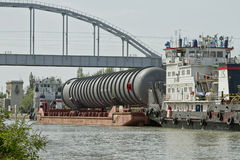 Transportation of bulky cargo on the barge Royalty Free Stock Images