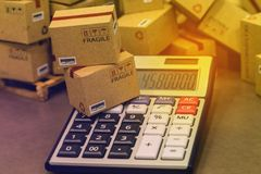 Transportation business concept : small papers boxes and calcula Royalty Free Stock Photos