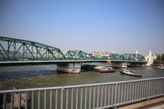 The Thonburi side of Bangkok, Thailand on January 13, 2019 in the morning. Transportation of the car and boat at the Buddha Yodfah Bridge Is a bridge across the royalty free stock images