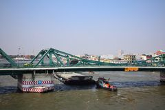 Bangkok, Thailand on January 13, 2019 in the morning. Transportation of the car and boat at the Buddha Yodfah Bridge Is a bridge across the Chao Phraya River royalty free stock image