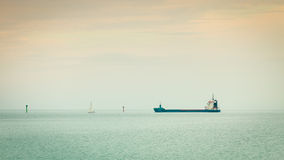Transportation. Cargo conteiner ship sailing in still water Stock Photo