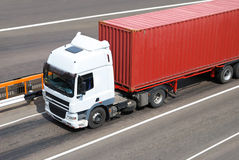 Transportation of cargoes by lorry. Transportation of cargoes in containers by lorry Stock Photos