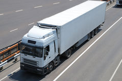 Transportation of cargoes by lorry. Transportation of cargoes in containers by lorry Stock Photography